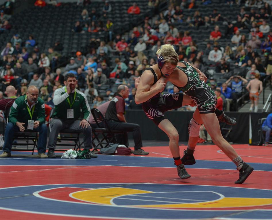 . Brady Hankin attempts a takedown on Estes Park High School sophomore Elijah Kitchen.