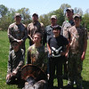 The whole crew smiling about Garrets first gobbler down.