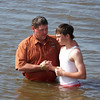 Bryce getting Baptized in Red River