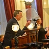 KRISTOPHER RADDER — BRATTLEBORO REFORMER<br /> Vermont Gov. Phil Scott waits patiently to restart his State of the State address to a joint session of the general assembly in the house chambers at the Vermont State House, in Montpelier, Vt., as a group of climate change protesters interrupts his speech on Thursday, Jan. 9, 2020.