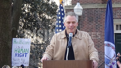 Terry McAuliffe attends a health care rally at Bell Tower on Capitol Square in Richmond, VA