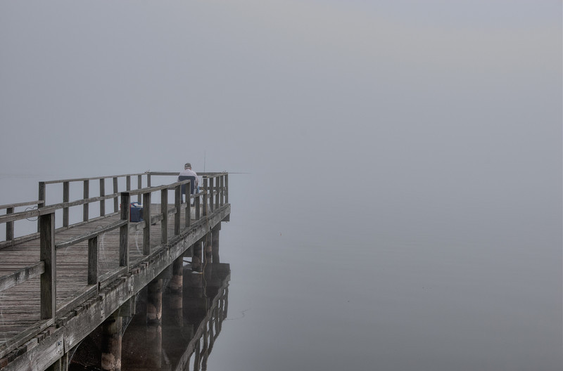 Fishing on a Pier in the Fog