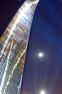 """""""The Gateway Arch"""" A close-up of the Arch with a full moon and several stars looking back at me."""