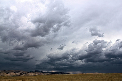 Took the back-road from Billings to Missoula and didn't see another car for more than 40 minutes, but caught this storm over the mountains.  As I stood on a completely empty road the silence almost caused a ringing in my ear only broken by the sound of thunder in the distance.