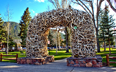 Jackson, Wyoming Town Square framed by the iconic arch of elk antlers.
