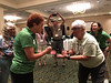 Imogene Treble (left) and Ida Swenson (right) duke it out in the finals of the Rock, Paper, Scissors tournament during Friday night icebreaker activities led by 4-H agent Terry Misch.