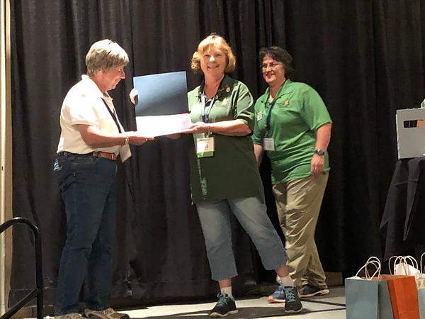 Dorothy Tepper receives photo contest award.