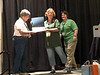 Dorothy Tepper receives photo contest award.