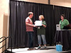 Kevin Divins receives photo contest award.