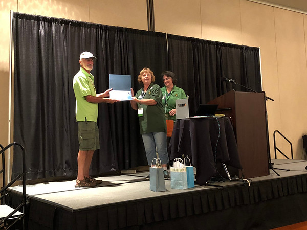 John Bunch receives photo contest award.