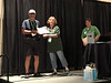 Rich Brager receives photo contest award.