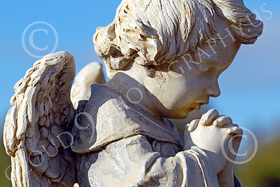 Sty-Angel 00004 A heart warming touching statutory depiction of a baby angel kneeling and praying, one of God's celestial attendants, statue picture by Peter J Mancus