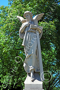 Sty-Angel 00011 An adult angel with cross and trumpet, one of God's celestial attendants, statue picture by Peter J Mancus