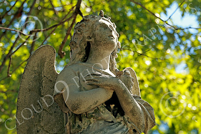 Sty-Angel 00002 One of God's celestial attendants with arms crossed looking upwards, statue picture by Peter J Mancus