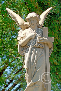 Sty-Angel 00003 An angel with trumpet and cross, one of God's celestial attendants, statue picture by Peter J Mancus