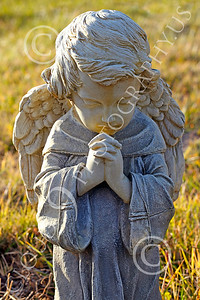 Sty-Angel 00007 A heart warming touching statutory depiction of a baby angel, one of God's celestial attendants, statue picture by Peter J Mancus