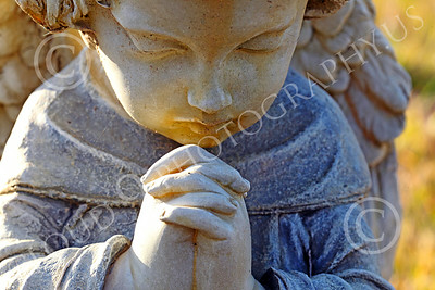 Sty-Angel 00006 A heart warming touching statutory depiction of a baby angel praying, one of God's celestial attendants, statue picture by Peter J Mancus