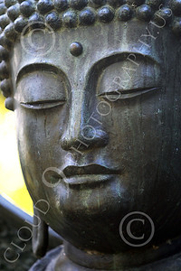STY - BUDDHA 00011 A tight vertical crop study of the face of a Buddha statue, by Peter J Mancus