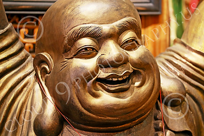 STY-BUDDHA 00026 Face of a jolly heavy set Buddha, statue picture by Peter J Mancus