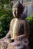 STY-BUDDHA 00056 A sitting heavily stained beautiful Buddha statue, statue picture by Peter J Mancus