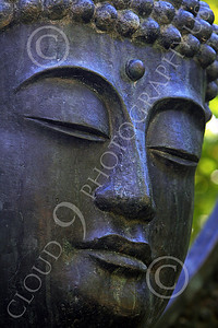 STY - BUDDHA 00013 A tight vertical crop study of the face of a Buddha statue, by Peter J Mancus