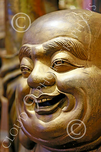 STY-BUDDHA 00019 Face of a jolly heavy set Buddha, statue picture by Peter J Mancus