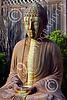STY-BUDDHA 00054 A sitting heavily stained beautiful Buddha statue, statue picture by Peter J Mancus