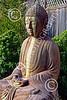 STY-BUDDHA 00058 A sitting heavily stained beautiful Buddha statue, statue picture by Peter J Mancus