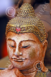 STY-BUDDHA 00017 Face of a Buddha wearing jeweled head gear, statue picture by Peter J Mancus