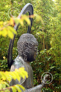 STY - BUDDHA 00023 A sitting Buddha statue with a vertical, circular, halo like object behind it, by Peter J Mancus