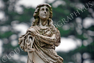 CemStat 00038 Cemetary statuary - Female figure, in the rain, leans on an anchor, by Peter J Mancus