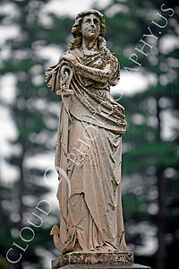 CemStat 00029 Cemetary statuary - Female figure, in the rain, leans on an anchor, by Peter J Mancus