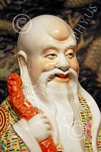 STY-CHIN 00003 Face of an elder Chinese man with beard, statue picture by Peter J Mancus
