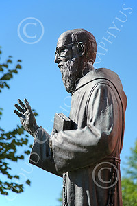 STY-JesP 00005 An extremely well done detail rich scholarly looking Jesuit priest, statue picture by Peter J Mancus