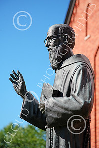 STY-JesP 00003 An extremely well done detail rich scholarly looking Jesuit priest, statue picture by Peter J Mancus