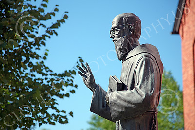 STY-JesP 00002 An extremely well done detail rich scholarly looking Jesuit priest, statue picture by Peter J Mancus