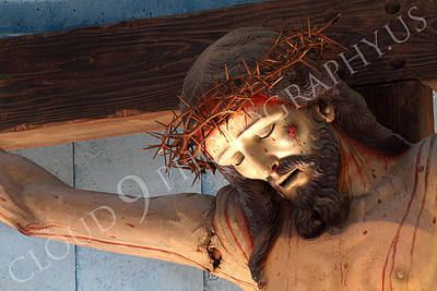 SpMis 00240 A grissly crucified Jesus Christ above the altar at Mission San Louis Rey, by Peter J Mancus