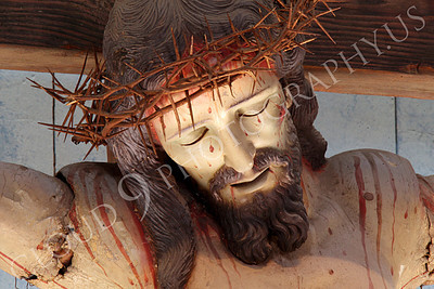 SpMis 00260 A tight crop of an artistic representation of the crown of thorns on a crucified Jesus Christ above the altar at Mission San Louis Rey, by Peter J Mancus