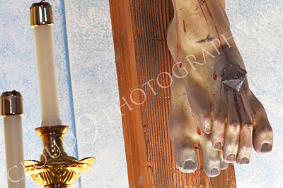 SpMis 00266 A tight crop of an artistic representation of a crucified Jesus Christ's feet above the altar at Mission San Louis Rey, by Peter J Mancus