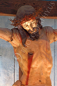 SpMis 00285 A spear wound in a crucified Jesus Christ art work above the altar at Mission San Louis Rey, by Peter J Mancus