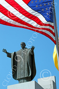 STY - POPEJP 00007 An excellent statue of Pope John Pau near the US flag, by Peter J Mancus