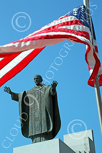 STY - POPEJP 00009 Two powerful symbols togethert--the US flag and a wonderful statue of a Roman Catholic pope, by Peter J Mancus
