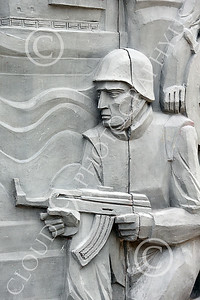 STY-RomMil 00021 Part of military scenes at the base of a large impressive statue in Bucharest to honor Romania's military heroes who died on duty, picture by Peter J Mancus