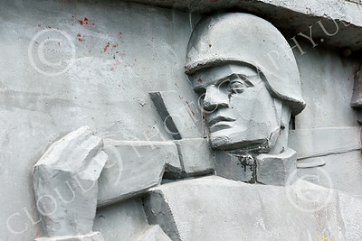 STY-RomMil 00026 Part of military scenes at the base of a large impressive statue in Bucharest to honor Romania's military heroes who died on duty, picture by Peter J Mancus