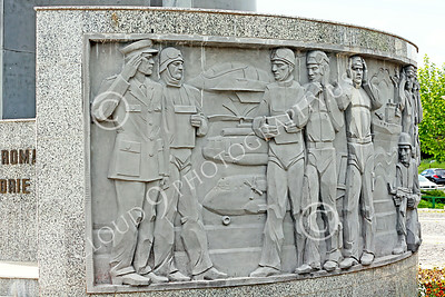 STY-RomMil 00024 Part of military scenes at the base of a large impressive statue in Bucharest to honor Romania's military heroes who died on duty, picture by Peter J Mancus