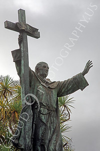 Sty - Spanish Jesuit Priest 00003 Spanish Jesuit priest with cross holds left hand high, by Peter J Mancus