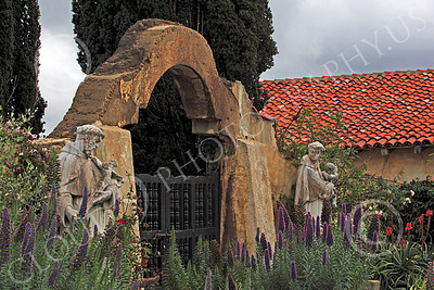 SMRSTY 00012 Two Franciscan priests at an entrance to Mission Carmel, by Peter J Mancus