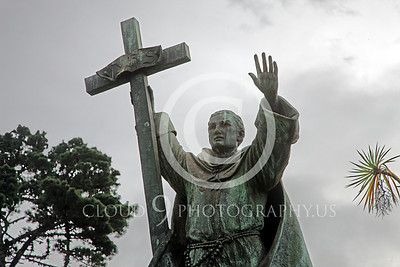 Sty - Spanish Jesuit Priest 00002 Spanish Jesuit priest with cross holds left hand high, by Peter J Mancus