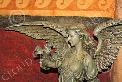 SMRSTY 00003 An angel with a dove on its arm, at Mission Carmel, by Peter J Mancus