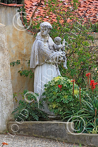 SMRSTY 00019 A Franciscan priest holding an infant, at Mission Carmel, by Peter J Mancus